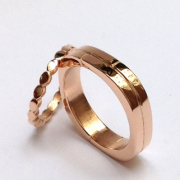 This pair of original matching pink gold wedding rings for women and men is a modern and contemporary custom creation, which allows everyone to wear a wedding ring that suits them.