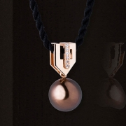 "The ""Félicia"" contemporary art deco style pendant is made of red gold and set with diamonds. A chocolate cultured pearl is suspended from it. This jewel is signed by Annette Girardon."