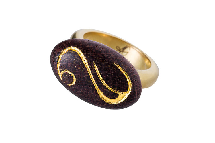 22 carat gold and wood ring encarved and decorated with gold leave.