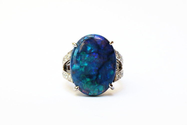 Fine jewellery ring with a large ovale black opal from Australia.