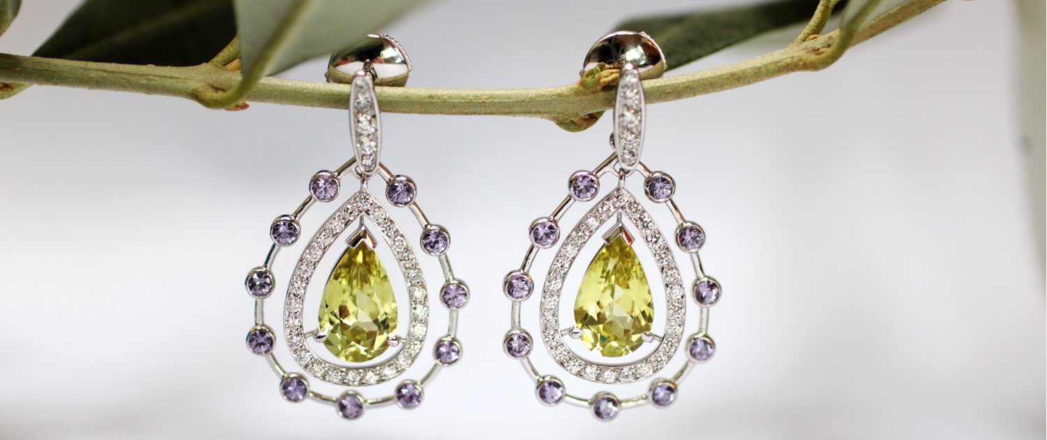 Bespoke earrings in drop shape with chrysoberyl, sapphires and diamonds.