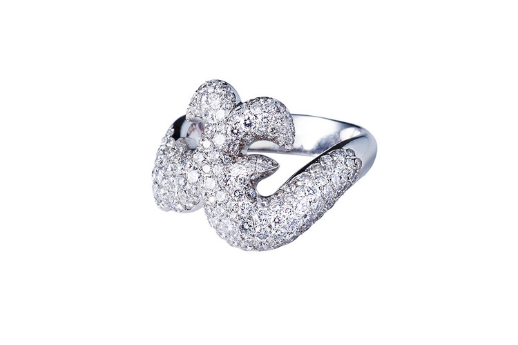 High end jewelry ring in white gold with diamond pavee.