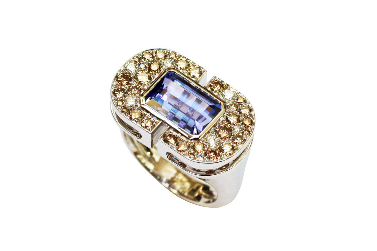 White gold tanzanite ring with brown and white diamonds
