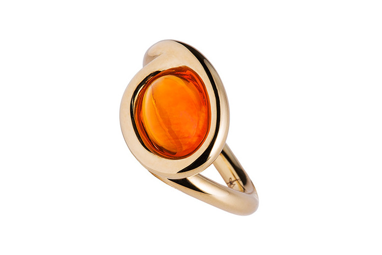 Dynamic shape for this ring in 18 carat gold with fire opal.