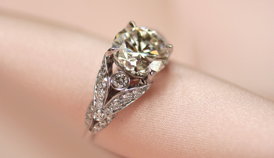 Custom made romantic engagement ring in white gold set with diamonds