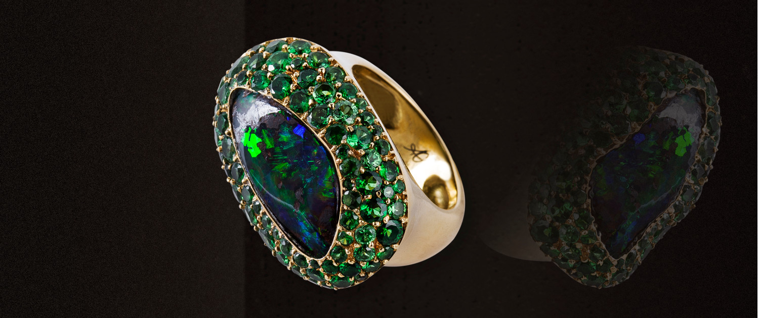 Gold opal ring with green tzavorite pavé, in a round cocktail ring style