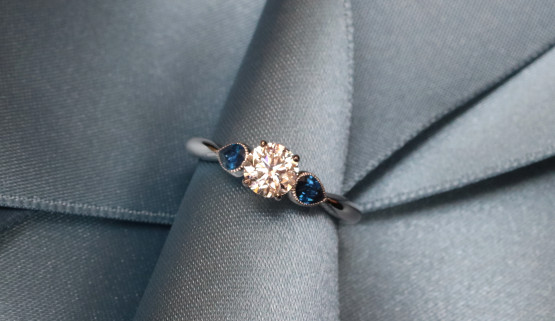 This classic white gold engagement ring features a diamond and two drop-shaped sapphires. It was made in Paris by Annette Girardon.
